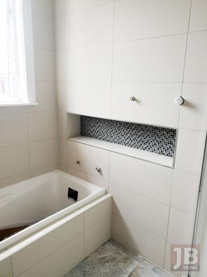 Drop floor bathroom shower. Fully tiled and waterproofed.